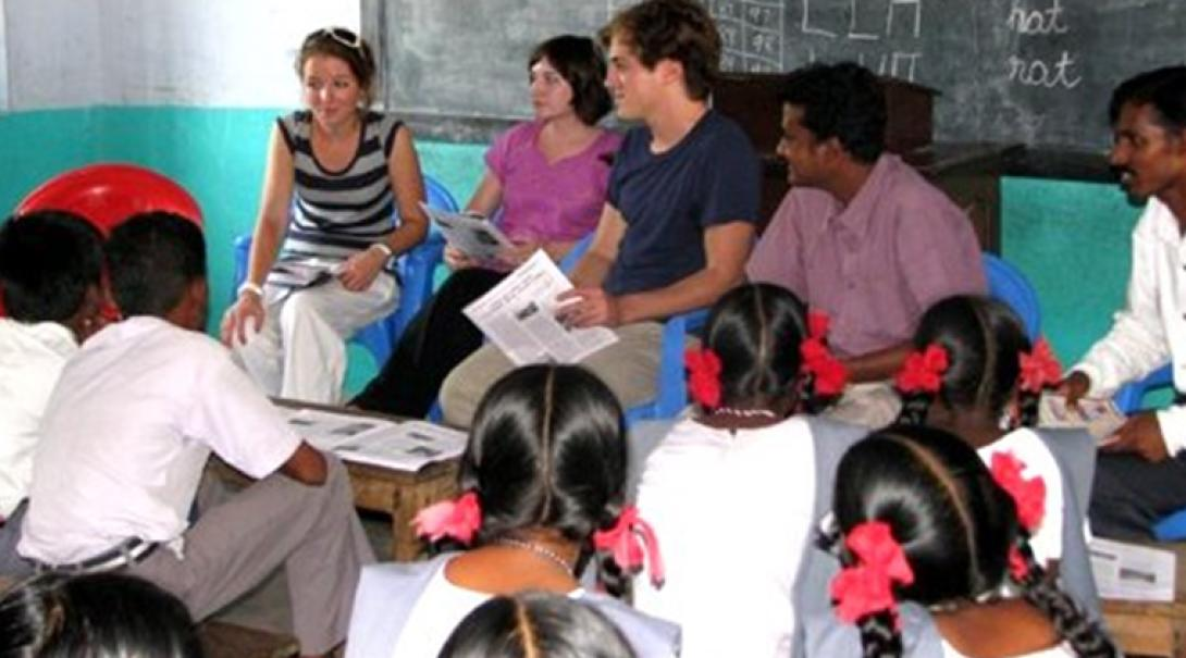 Teaching volunteers use the teaching resources they created during class in India.